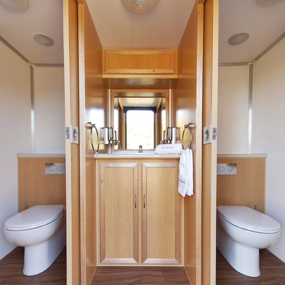 Units outhouse portable restroom square the outhouse for Deluxe portable bathrooms